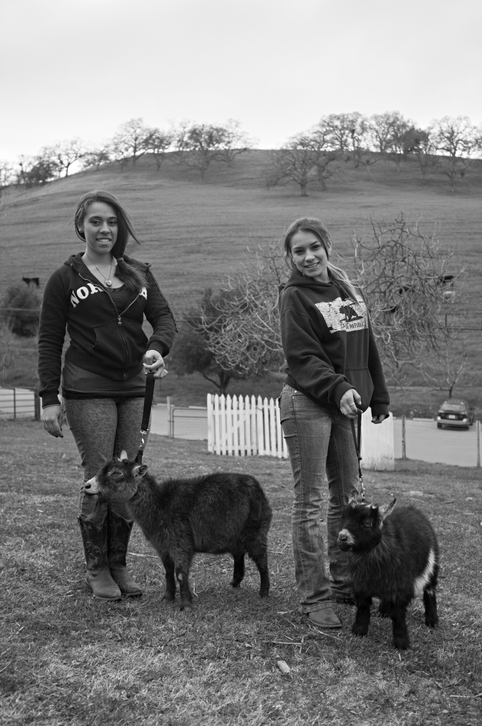 Allison and Sydney with their goats at Borges Ranch. Photo by Rafael Roy.