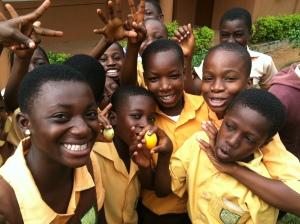 "An elementary school 4-H club in Ghana shows off a ""garden egg"" (eggplant) that they grew. Photo by Kiera Butler."